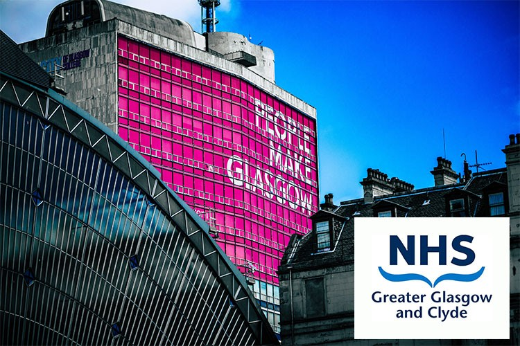 Image of building in Glasgow with 'people make Glasgow' sign with an NHS Greater Glasgow and Clyde logo over the top
