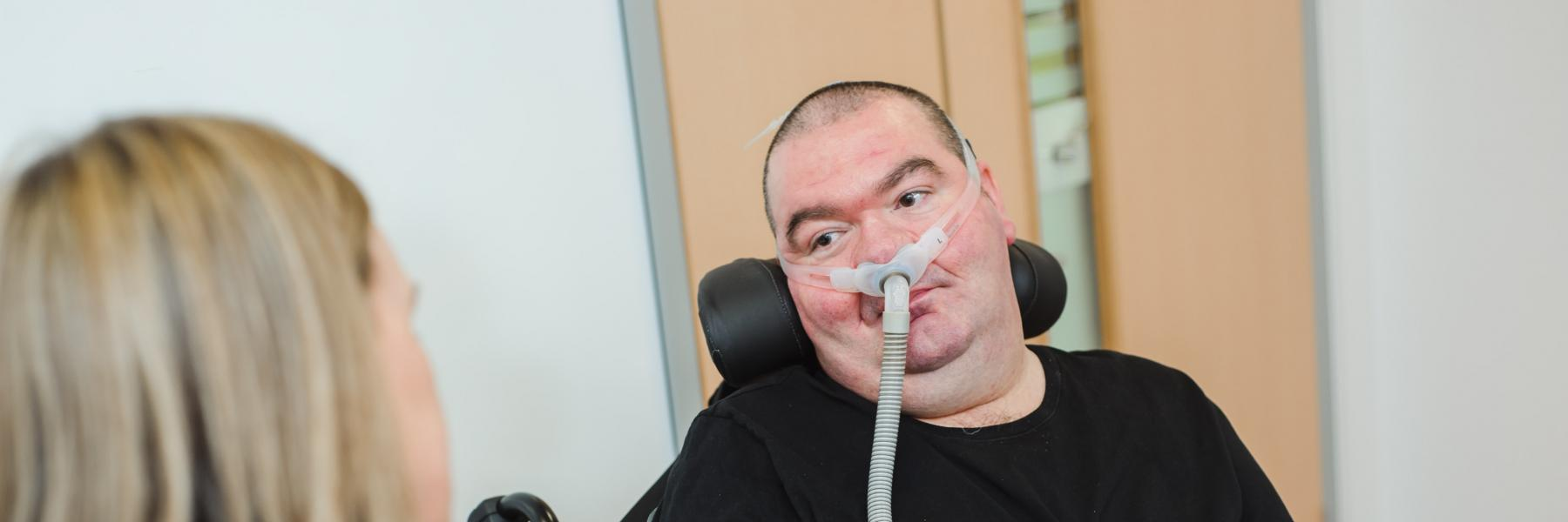 Person with MND with ventilator